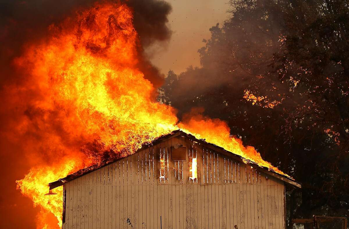 A home burns as the River Fire moves through the area on July 31, 2018 in Lakeport, California. The River Fire has burned over 27,000 acres, destroyed seven homes and stands at only eight percent contained.