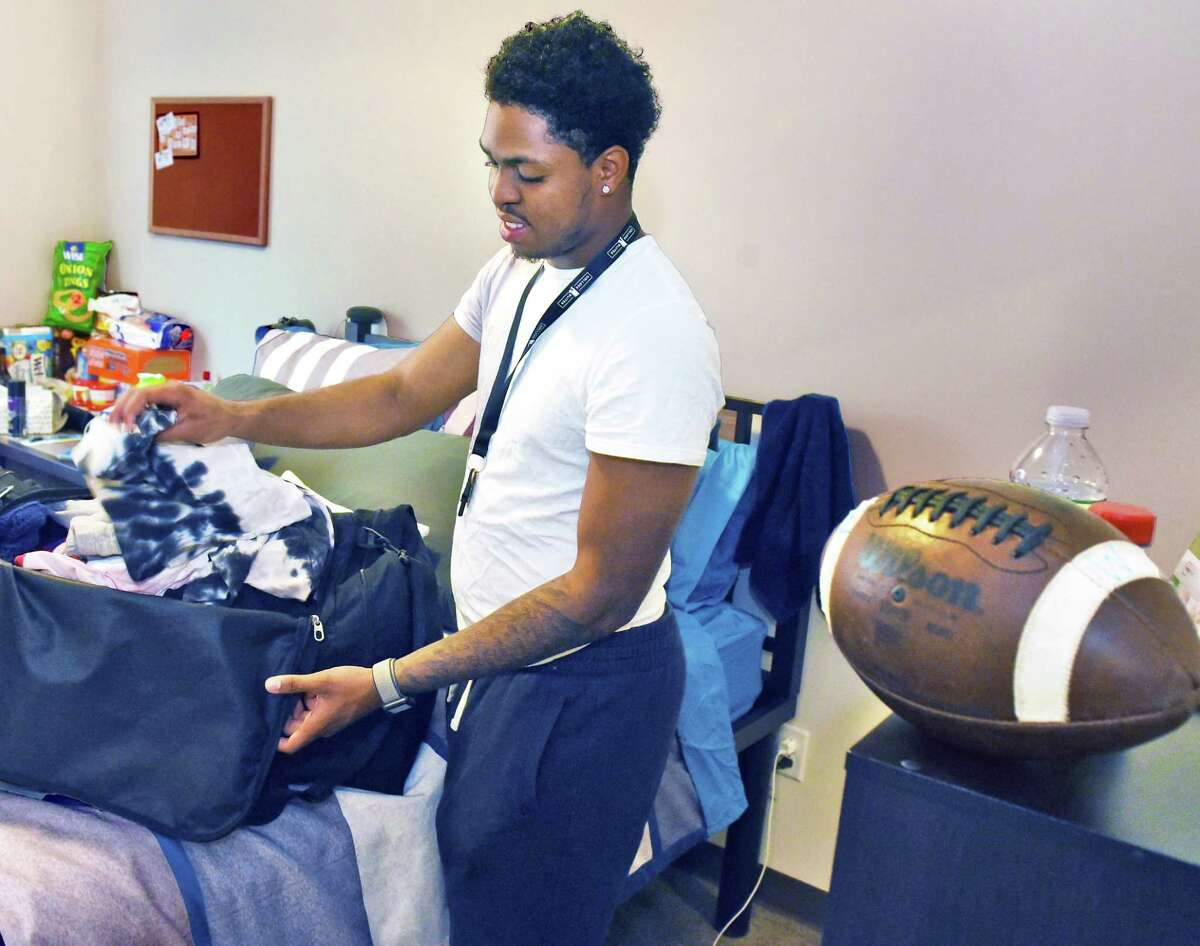 Football player Shamar Patrick of Long Island unpacks in his new room during Athlete Move-in at the College Suites at Hudson Valley Wednesday August 1, 2018 in Troy, NY. (John Carl D'Annibale/Times Union)