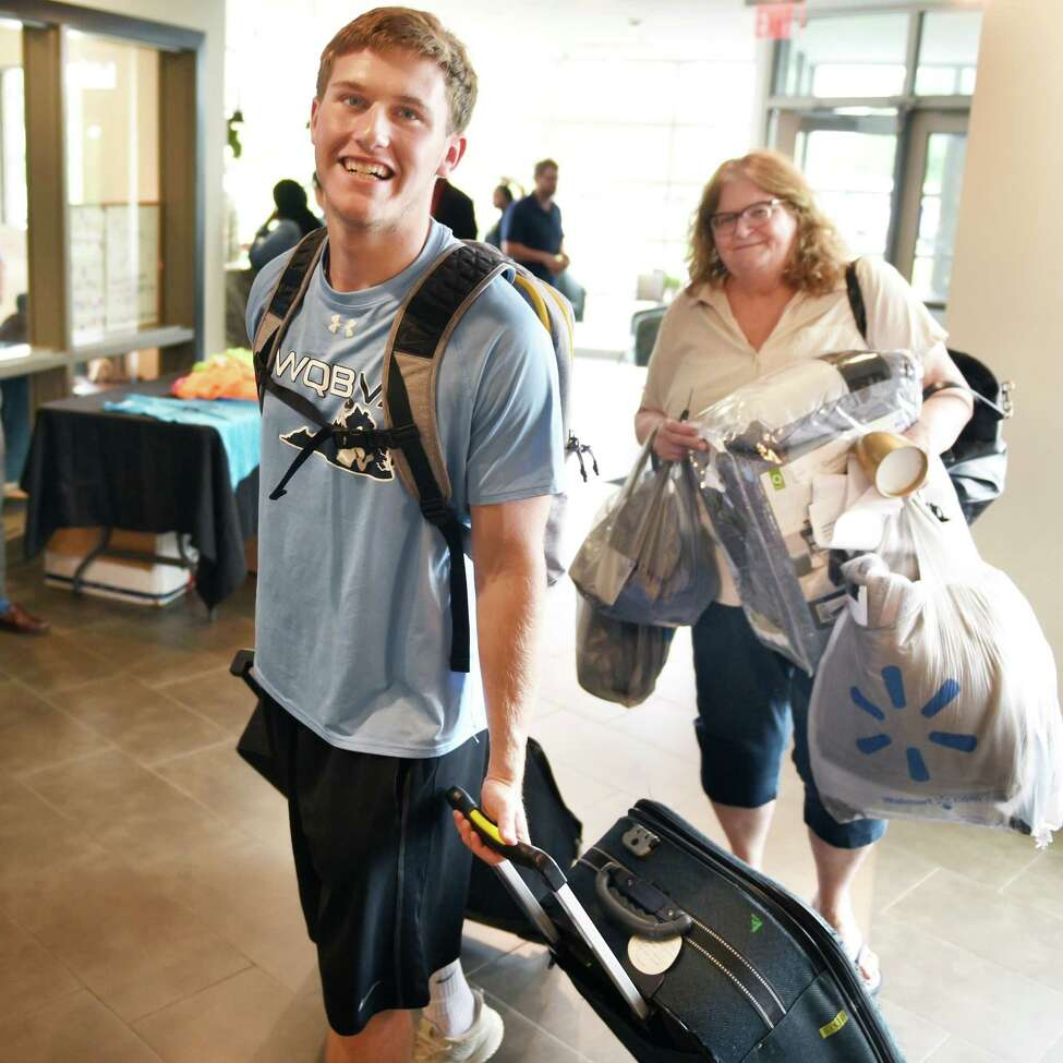 Football player John Cochran of Vienna, Virginia gets help from his mother Sharron carrying in his belongings during Athlete Move-in at the College Suites at Hudson Valley Wednesday August 1, 2018 in Troy, NY. (John Carl D'Annibale/Times Union)