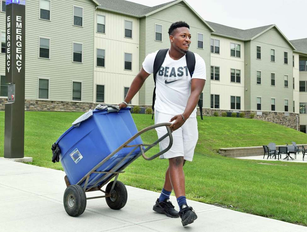 Football player Tahj Snow of Rochester wheels in his belongings during Athlete Move-in at the College Suites at Hudson Valley Wednesday August 1, 2018 in Troy, NY. (John Carl D'Annibale/Times Union)