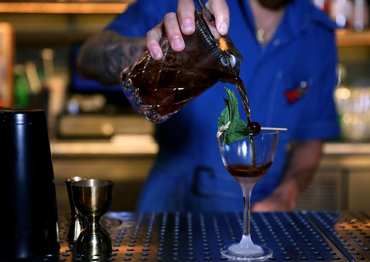 Bartender Gabriel Lowe makes a Valley of the Shadow, a cocktail at Last Rites, in San Francisco, Cali. on Tuesday, July 31, 2018. The new tiki bar is located at 718 14th St., in the Duboce/Castro neighborhood.