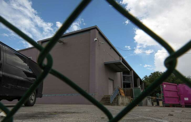 Southwest Key Programs, a non-profit group that houses unaccompanied immigrant children, says it has all but one of the permits it needs to open the controversial facility at a former homeless shelter, pictured, at 419 Emancipation Ave. City of Houston officials, including Mayor Sylvester Turner, disputed that, saying the nonprofit still needs to obtain city permits. ( Godofredo A. Vasquez / Houston Chronicle )