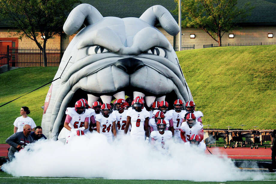 ANGRY RED: The Plainview Bulldogs football team prepares to run onto the field before a regular season game in 2017. The number of students participating in athletics each year at Plainview High School has either increased or stayed the same, according to athletic director Ryan Rhoades. Photo: Bulldogs Athletics