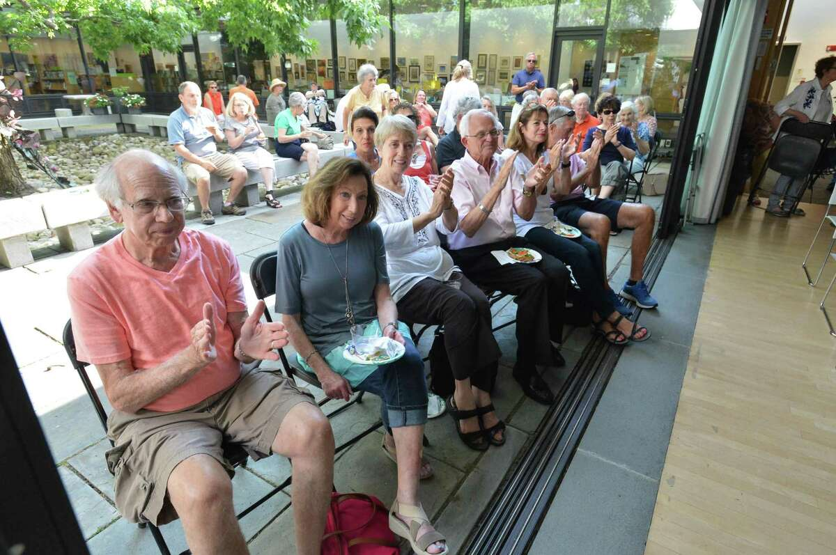 The courtyard doors are opened during the Echoes of Sinatra performance at the Wilton Library Summer Music and More Concert Series on Sunday July 29, 2018 in Wilton Conn.