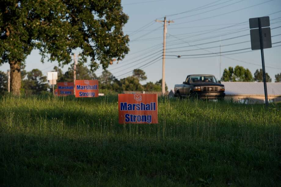 "Signs reading ""Marshall Strong"" line the roadside in Benton, Ky. In January, nearby Marshall County High School was the site of a deadly school shooting. M Photo: Brandon Dill/For The Washington Post / Brandon Dill"