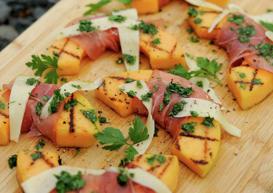 Grilled Cantaloupe with Prosciutto and Asiago Cheese Photo: Paul Stephen /Staff