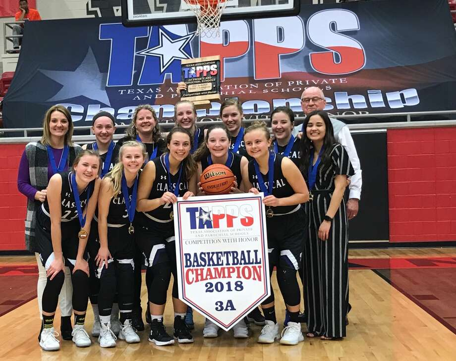 Members of the Midland Classical Academy girls' basketball team pose after winning the TAPPS 3A state title with a 59-53 double overtime victory over Beaumont Legacy at West High School on March 3. Photo: Courtesy Photo