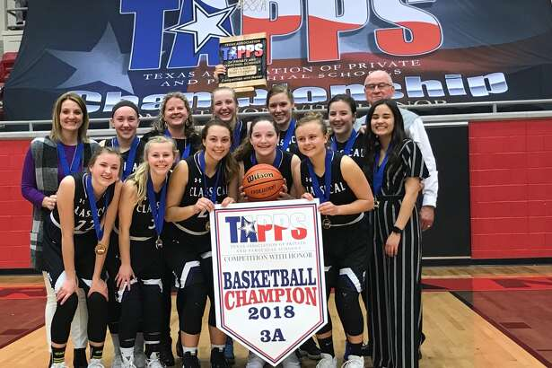 Members of the Midland Classical Academy girls' basketball team pose after winning the TAPPS 3A state title with a 59-53 double overtime victory over Beaumont Legacy at West High School on March 3.