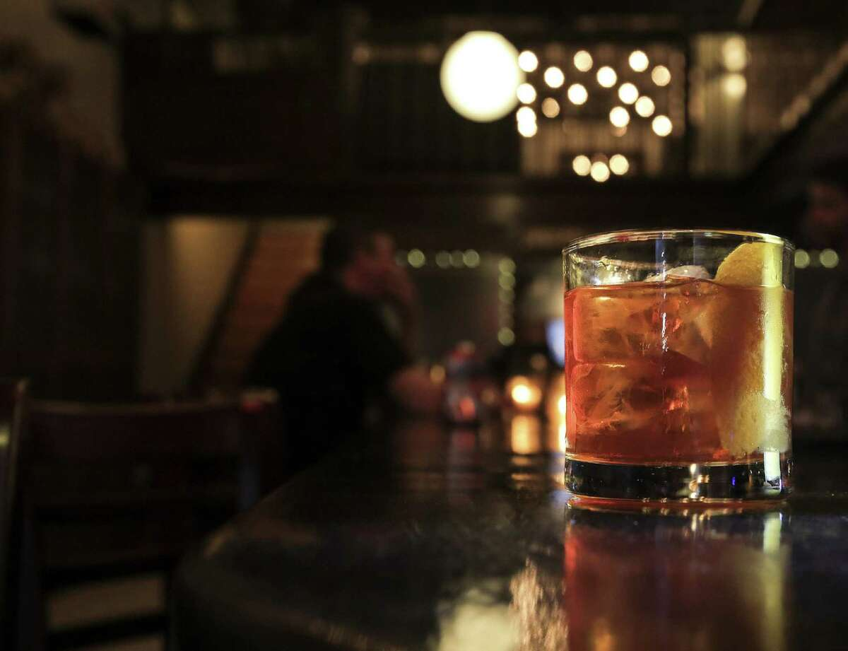 The bar at the end of the drink or is it the other way around? An old fashioned sits idle at the Houston Watch Company.