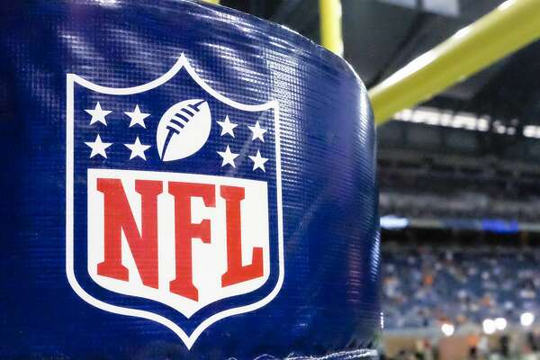 FILE - This Aug. 9, 2014 file photo shows an NFL logo on a goal post pad before a preseason NFL football game between the Detroit Lions and the Cleveland Browns at Ford Field in Detroit.  (AP Photo/Rick Osentoski, File)