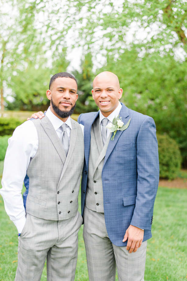Jarell, left, and Jamion Christian at Jamion Christian's wedding on May 5. (Courtesy of Jamion Christian) Photo: Jamion Christian