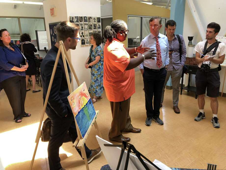 Gubernatorial candidate Ned Lamont toured the Connecticut Center for Arts and Technology in New Haven Tuesday. Above, Steve Driffin, youth and community programs manager, leads Lamont and others through the space. Photo: Ben Lambert / Hearst Connecticut Media /