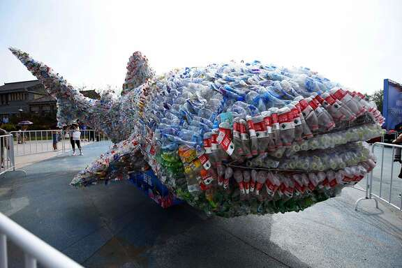 TOPSHOT - This photo taken on July 21, 2018 shows an installation depicting a whale shark made of plastic bottles in Rizhao Ocean Park in Rizhao, China's eastern Shandong province.  Some 12 million tonnes of plastic, mostly in the form of single-use packaging, are dumped into the world's oceans per year creating an ecological nightmare. / AFP PHOTO / - / China OUT-/AFP/Getty Images