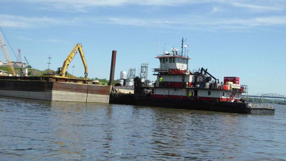 A tugboat works along side a river trestle at the Port of Coeymans last week. Photo: Photo Provided