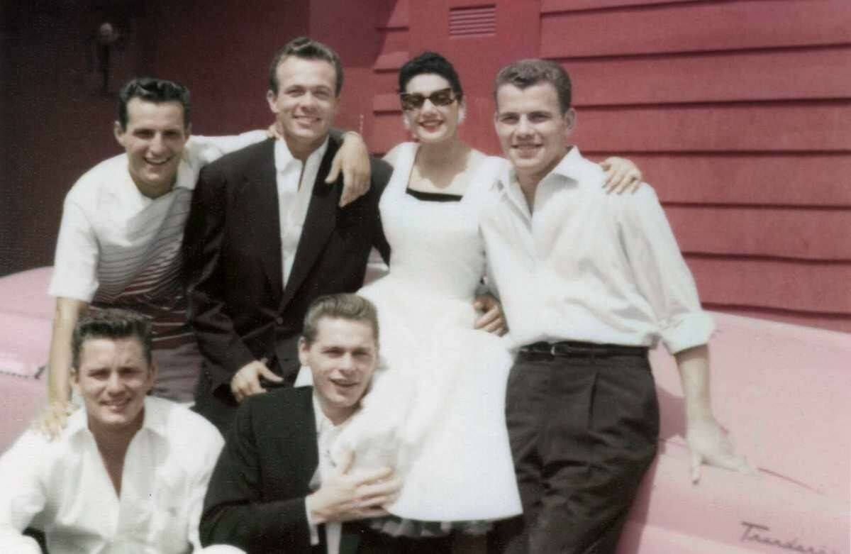 Scotty Bowers (second from left, back row), with friends in 1940s Hollywood, arranged hookups for stars.