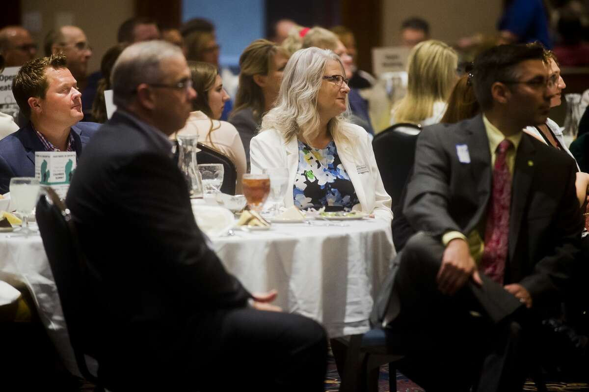 People listen to speakers during the Great Lakes Bay Regional Chamber Summit on Wednesday, Aug. 1, 2018 at Great Hall Banquet & Convention Center. (Katy Kildee/kkildee@mdn.net)