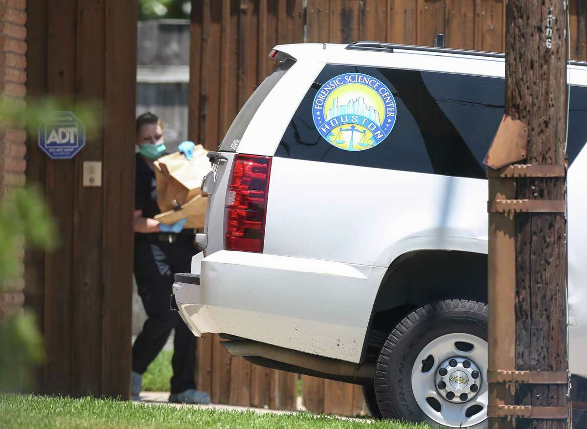 HPD investigative officials transfer collected items from a house located near the intersection of Doud Street and Stillbrooke Drive into the Houston Forensic Science Center van on Wednesday, Aug. 1, 2018, in Houston.