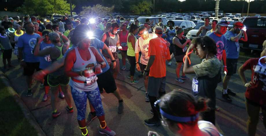 Runners wait for the start of the 5k, during third annual Universal City Roamin' the Hills of Olympia Toga Run held Friday, Aug. 11, 2017 at Olympia Hills golf course. The Toga Run benefits Special Olympics Texas. Photo: Edward A. Ornelas, Staff / San Antonio Express-News / © 2017 San Antonio Express-News