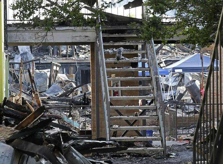 Only the staircase remained standing at this section of Building 500 at Iconic Village Apartments in San Marcos after a deadly fire was intentionally set there around 4:30 a.m. July 20. Five people were later found dead in the building, while another victim, Zachary Sutterfield, suffered critical injuries. Photo: Jerry Lara /Staff Photographer / San Antonio Express-News