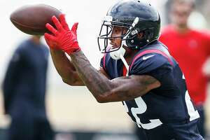 Houston Texans defensive back Aaron Colvin (22) reaches out to make a catch while running a drill during training camp at the Greenbrier Sports Performance Center on Wednesday, Aug. 1, 2018, in White Sulphur Springs, W.Va.
