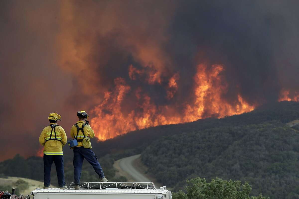 A fire crew from San Luis Obispo County keeps an eye on an advancing wildfire in Lakeport.