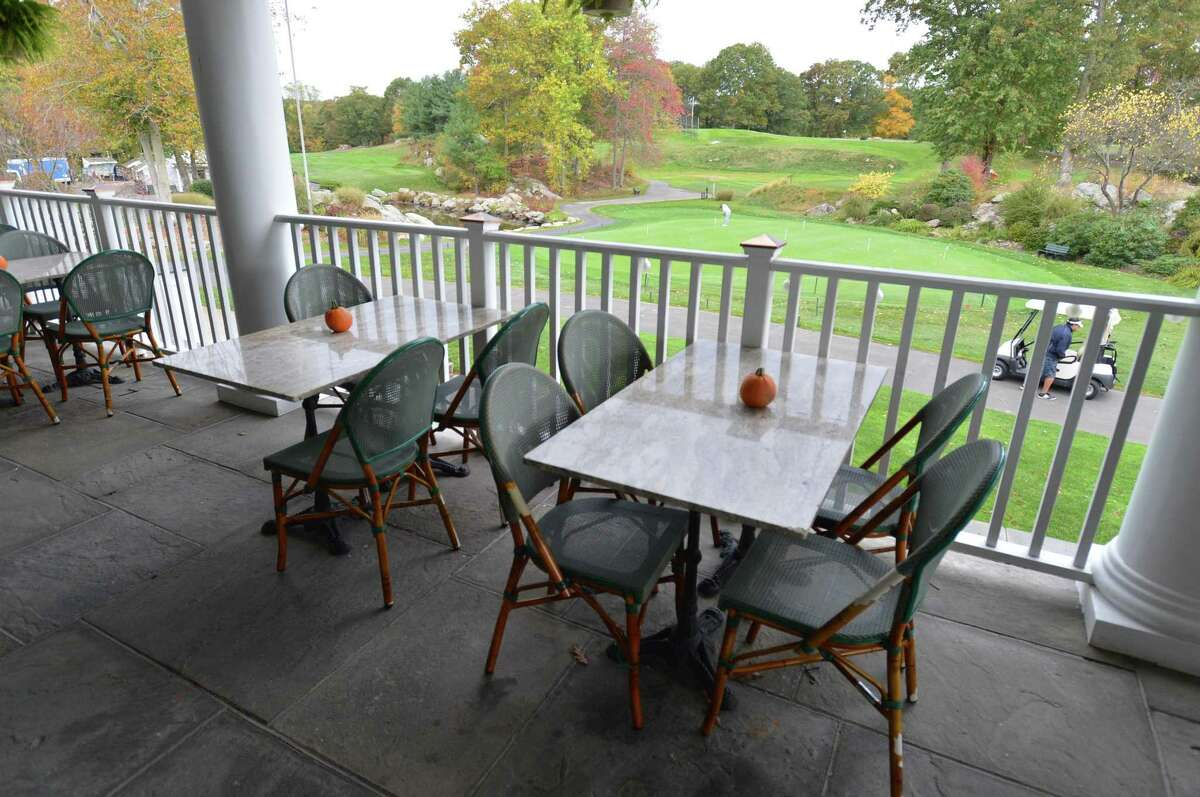 The terrace overlooking the putting green at the Oak Hills Restaurant on the Green at Oak Hills Park in Norwalk.