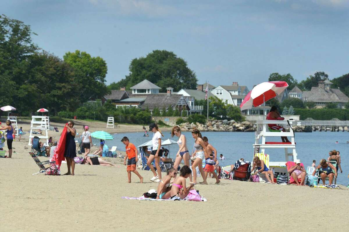 People enjoy a summer day at Calf Pasture Beach on Tuesday July 31, 2018 in Norwalk Conn.