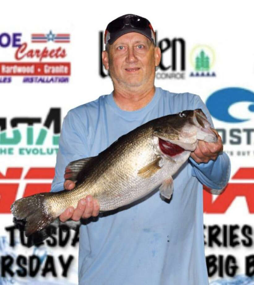 Ty Russell came in first place in the Thursday Individual Big Bass Tournament with a big bass weighing 8.10 pounds. Photo: Conroe Bass