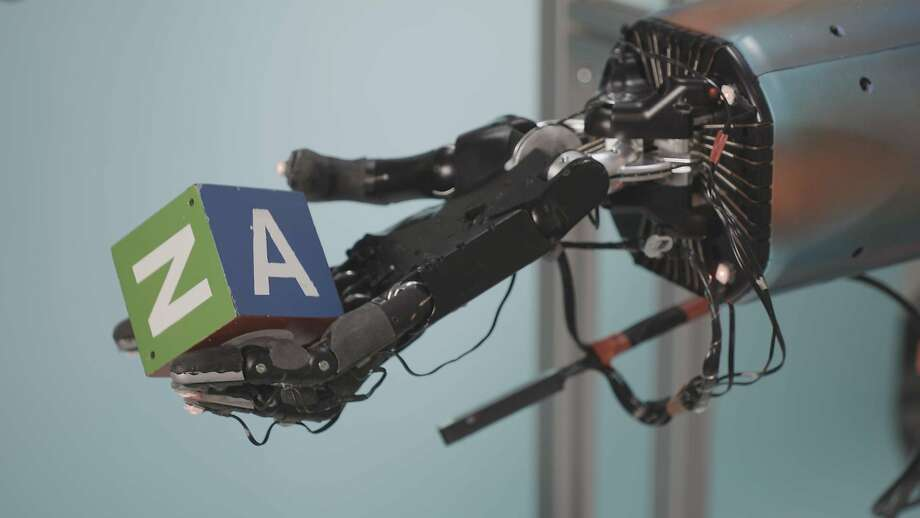 Robotic hands now can learn more complex tasks, rather than just what they have been programmed for. Photo: Tim Hussin / New York Times