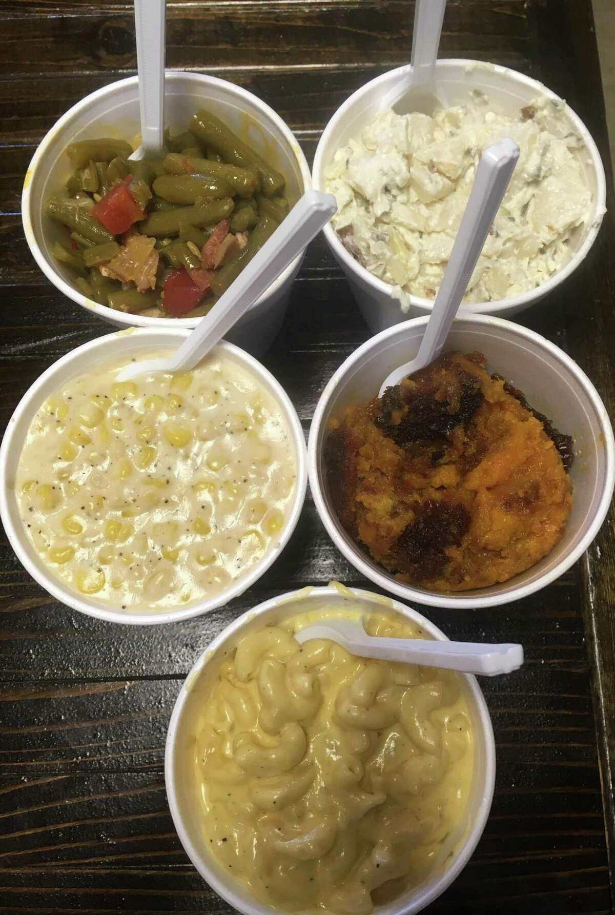 An assortment of sides at Dee Willie's BBQ Smokehouse include green beans, loaded baked potato salad, sweet potato casserole, mac-n-cheese and creamed corn.