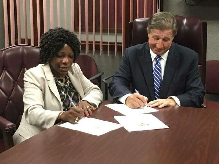 Kim Jones, the state director for the U.S. Department of Labor Office (USDOL) of Apprenticeship and Gerry Schuetzenhofer, chairman of the Madison-Bond Workforce Innovation Board, signed the Standards of Apprenticeship agreement designating the Madison-Bond Local Workforce Development Area with the Registered Apprenticeship Program Photo:     For The Telegraph
