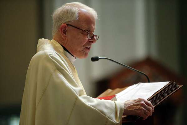 Pastor of St. James Cathedral Fr. Michael Ryan give the homily during a funeral mass for former Seattle Archbishop Raymond G. Hunthausen, Wednesday, Aug. 1, 2018.
