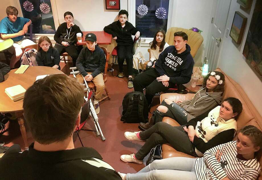 Members of the Young Entrepreneurs Academy, a national program sponsored locally by Ridgefield Chamber of Commerce for middle and high school students, listen to Noteworthy Chocolates owner Michael Sauvageau in Bethel, Conn., on Wednesday, Nov. 9, 2017. Photo: By Chris Bosak / Hearst Connecticut Media / The News-Times