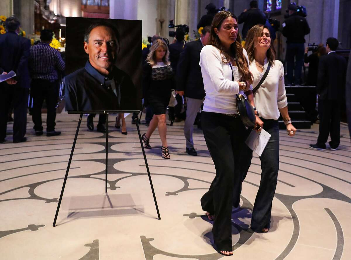 Kelly Radzikowski (center) walks out of her husband Dwight Clark's celebration of life at Grace Cathedral in San Francisco, California, on Wednesday, August 1, 2018