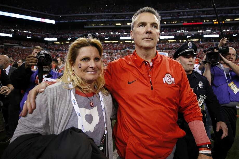 INDIANAPOLIS, IN - DECEMBER 02: Head coach Urban Meyer of the Ohio State Buckeyes celebrates with his wife Shelley following the Big Ten Championship against the Wisconsin Badgers at Lucas Oil Stadium on December 2, 2017 in Indianapolis, Indiana. (Photo by Joe Robbins/Getty Images) Photo: Joe Robbins/Getty Images