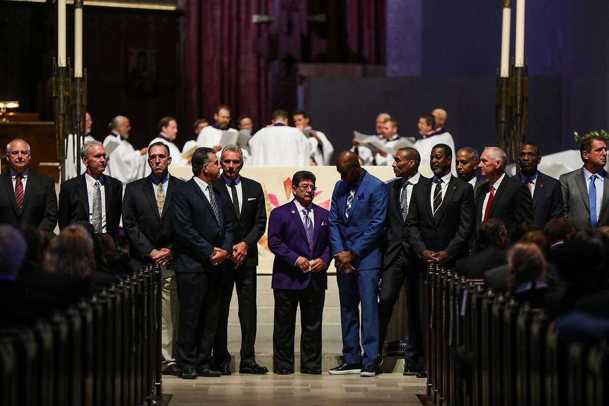 Former 49ers owner Eddie DeBartolo (center) stands with former players at Dwight Clark's memorial service at Grace Cathedral in San Francisco, California, on Wednesday, August 1, 2018
