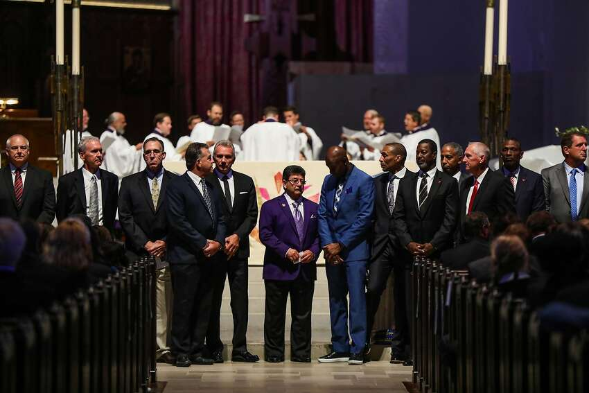 Former 49ers owner Eddie DeBartolo (center) stands with former players at Dwight Clark's memorial service at Grace Cathedral. Clark, a former 49ers wide receiver, died from complications related to ALS on June 4.