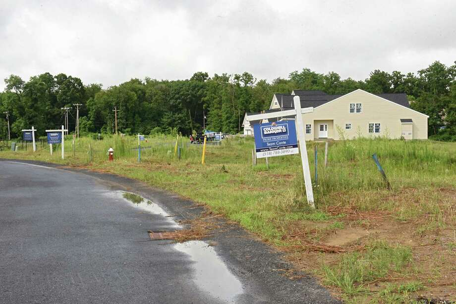 Homes under construction are seen beyond empty lots at Maxwell Village on Wednesday, Aug. 1, 2018 in Colonie N.Y. The housing development off Maxwell road currently has occupied homes, completed homes for sale, homes under construction and lots to be built on. (Lori Van Buren/Times Union) Photo: Lori Van Buren, Albany Times Union / 20044472A