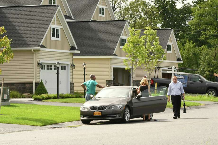 People look at a home at Maxwell Village with their real estate agent on Wednesday, Aug. 1, 2018 in Colonie N.Y. The housing development off Maxwell road currently has occupied homes, completed homes for sale, homes under construction and lots to be built on. (Lori Van Buren/Times Union) Photo: Lori Van Buren, Albany Times Union / 20044472A