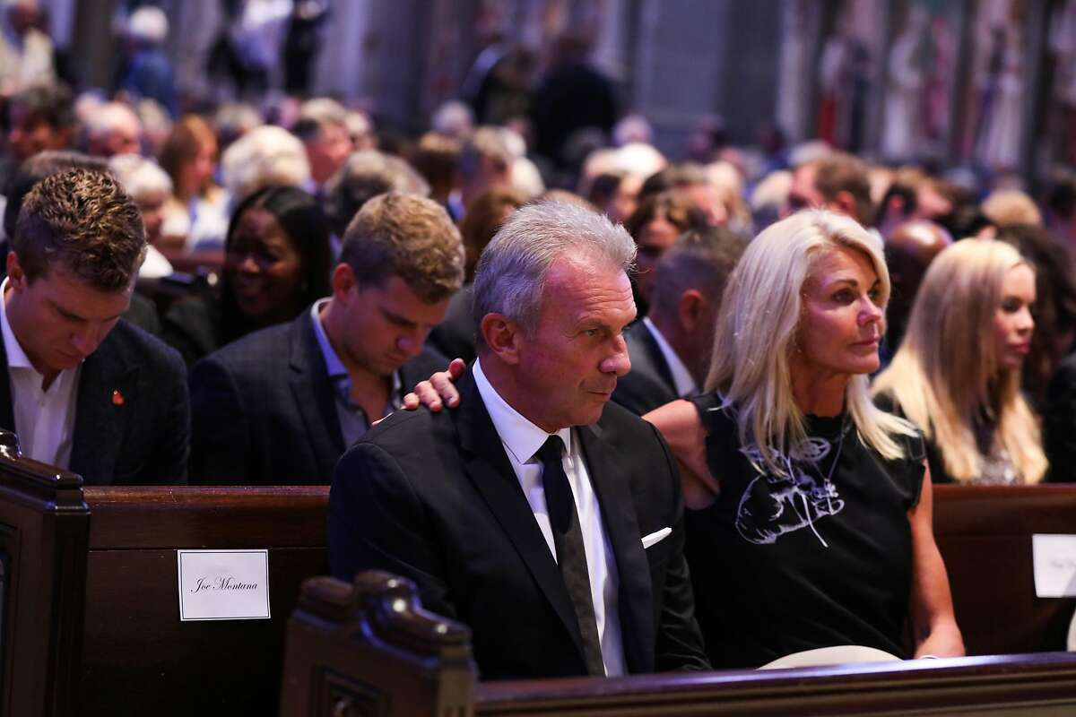 Joe Montana and wife Jennifer Montana become emotional ahead of Dwight Clark's celebration of life service at Grace Cathedral in San Francisco, California, on Wednesday, August 1, 2018