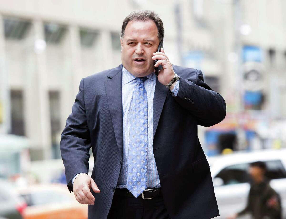 Lawyer Domenic Basile arrives at court representing former Toronto Blue Jays baseball pitcher Roberto Osuna in Toronto, Wednesday, Aug. 1, 2018. Osuna was arrested in May and charged with assault in connection to an alleged domestic incident. Osuna was suspended without pay for 75 games in June for violating Major League Baseball's domestic violence policy. The Toronto Blue Jays traded the pitcher to the Houston Astros on Monday. (Nathan Denette/The Canadian Press via AP)