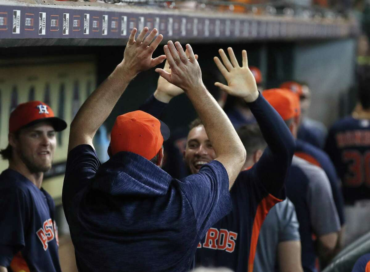 Houston Astros George Springer (4) and Justin Verlander celebrate together afterTyler White hit a home run during the second inning of an MLB game at Minute Maid Park, Sunday, July 29, 2018, in Houston.