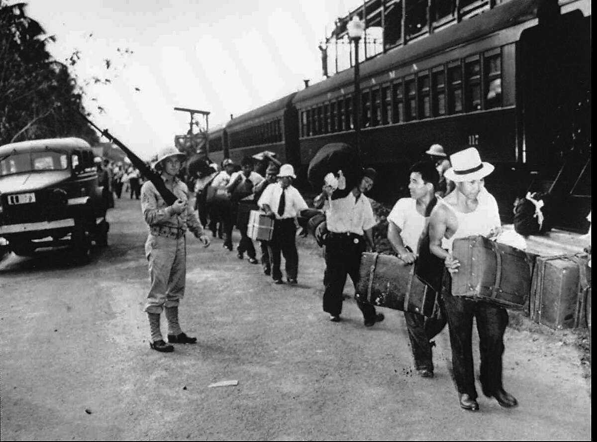 FILE--Japanese Latin Americans are shown in an unknown location en route to internment camps in the United States during World War II in this undated photo from the National Japanese American Historical Society. A class action suit against the United States was filed Wednesday, Aug 28, 1996, on behalf of the Japanese Latin Americans who were abducted and deported to the United States, then held to be exchanged for American prisoners of war. (AP Photo/National Japanese American Historical Society) Ran on: 09-05-2004 Ethnic Japanese are rounded up and interned during World War II; suits were filed on behalf of many of them for restitution.