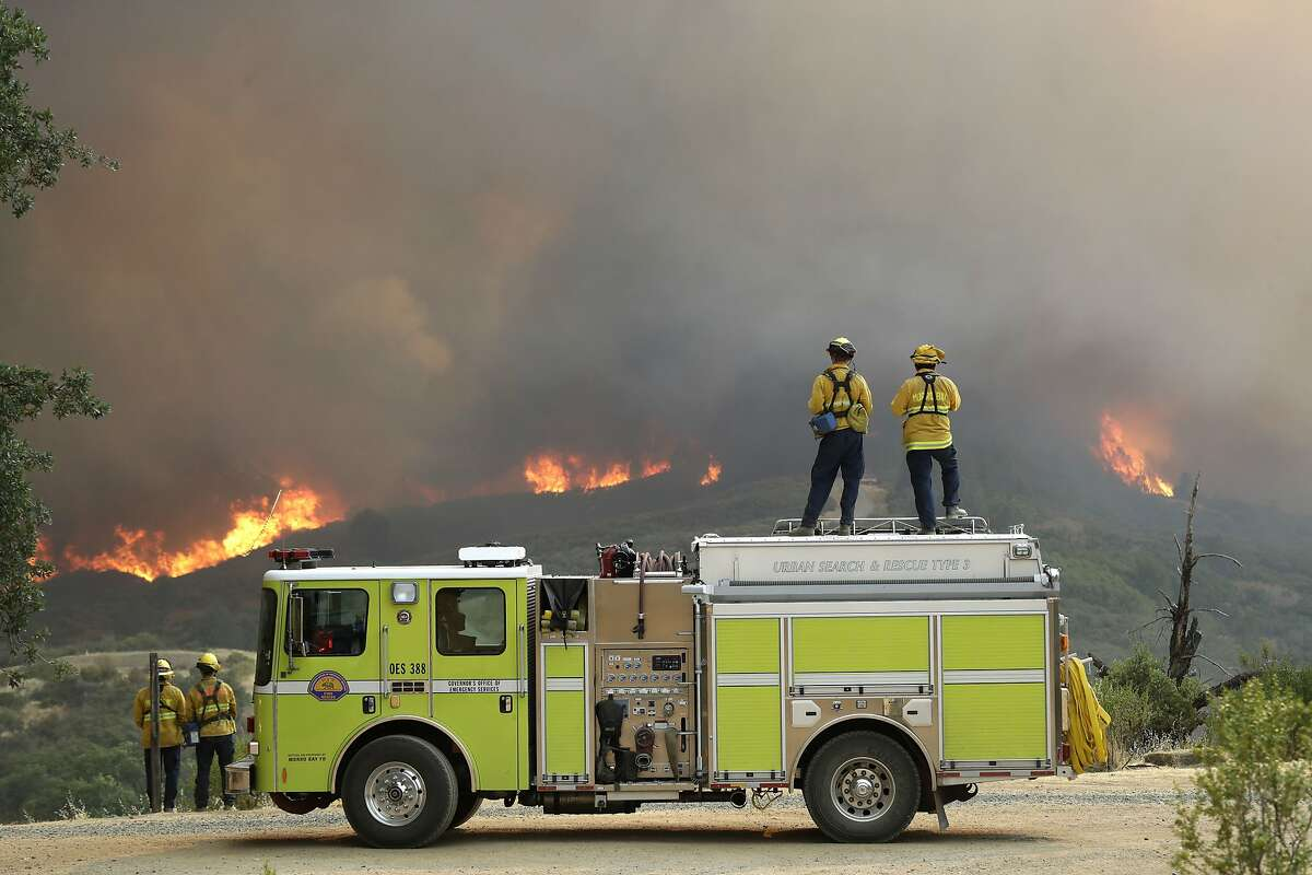 A fire crew from San Luis Obispo County keeps an eye on an advancing wildfire in Lakeport (Lake County), where the Mendocino Complex fire is burning.