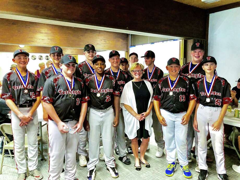 Members of the Torrington Little League team headed for New Jersey Wednesday to play in the regional championships. If they win, they'll go on to play in the World Series game in Michigan. The team held a pasta supper fundraiser Tuesday night and celebrated their accomplishments with Mayor Elinor Carbone, pictured above, state Rep. Michelle Cook, family and friends. Photo: Carole Campbell / Contributed Photo /