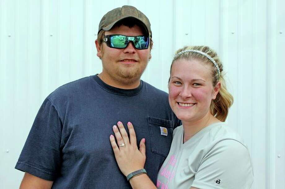 Coy Hansen and Darcy Lipskey pose after getting engaged at the Huron Community Fair Monday morning. (Brenda Battel/Huron Daily Tribune)