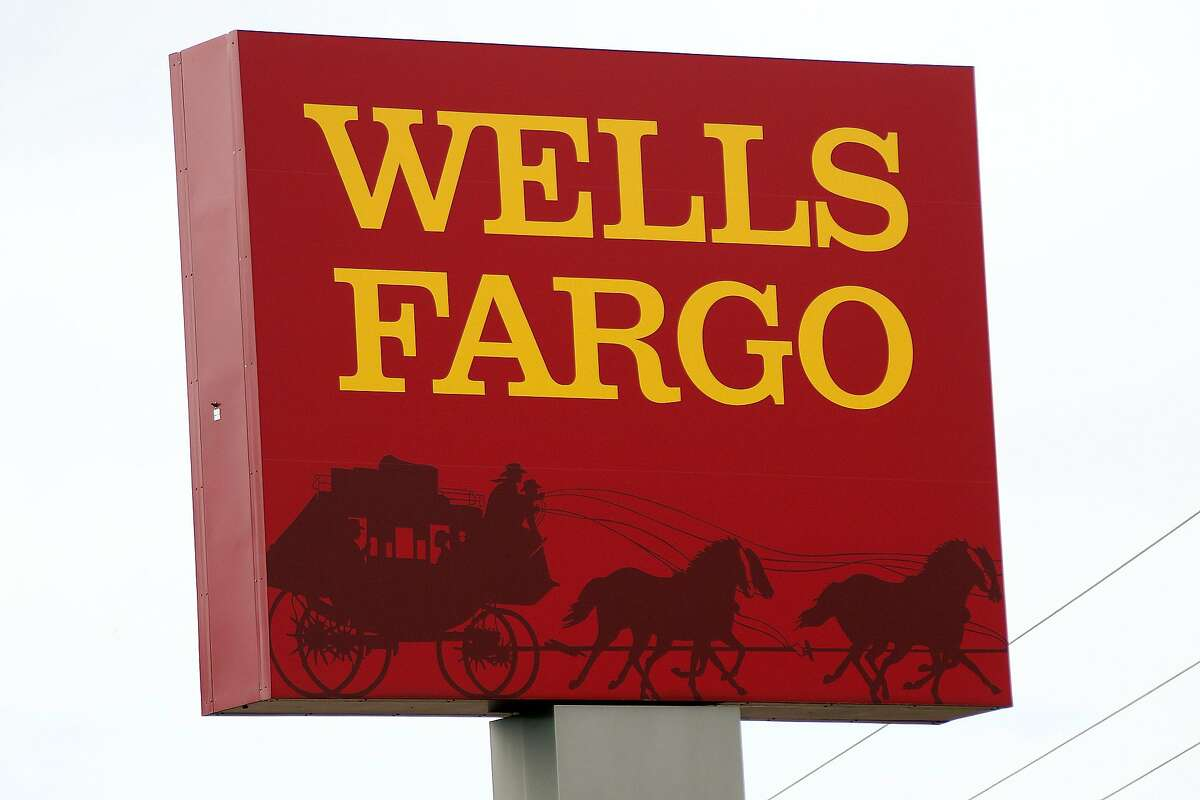 FILE - This April 11, 2017, photo shows a Wells Fargo bank in northeast Jackson, Miss. Wells Fargo agreed Wednesday, Aug. 1, 2018, to pay a $2.1 billion fine to settle allegations it misrepresented the types of mortgages it sold to investors during the housing bubble that ultimately led to the 2008 financial crisis.