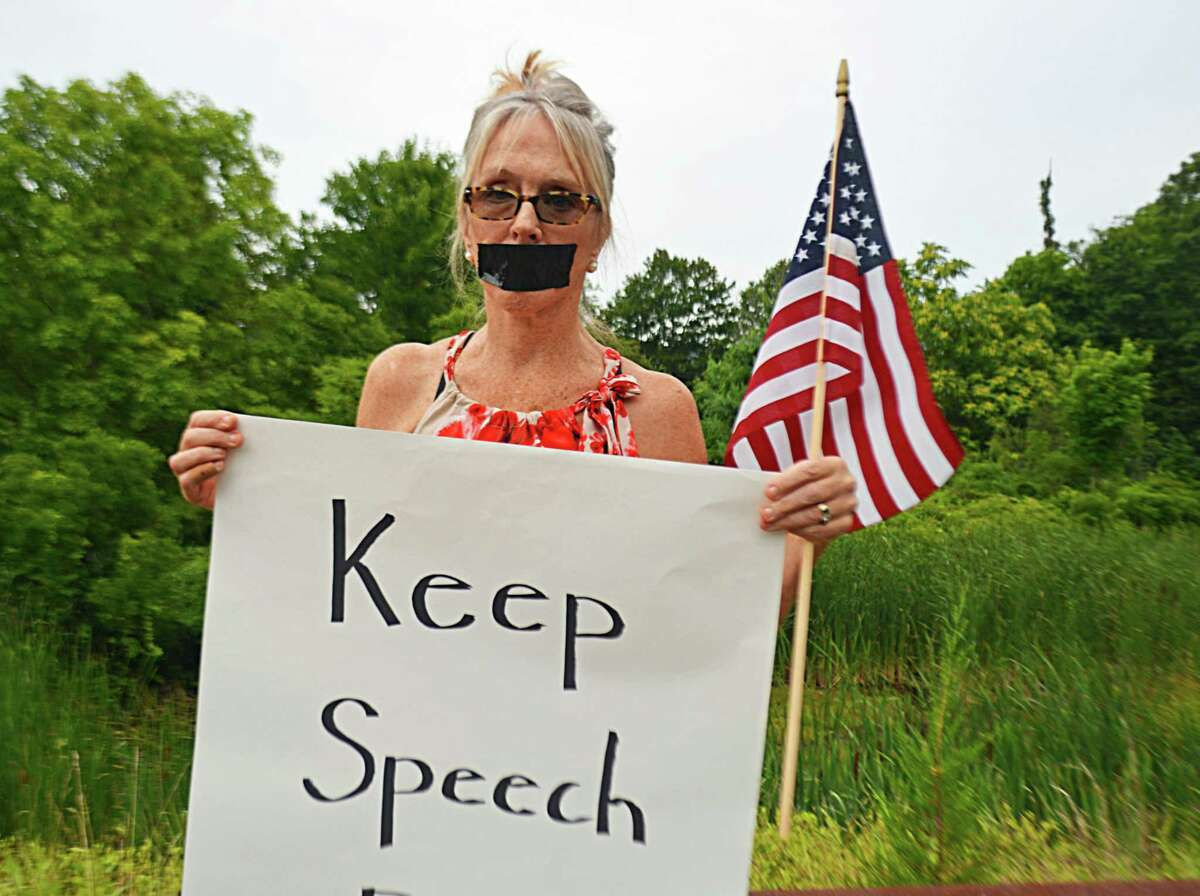 Haddam Selectwoman Melissa Schlag was condemned during the Board of Selectmen's meeting Monday night, as person after person spoke against her taking a knee during the Pledge of Allegiance. Her supporters formed a long line along the driveway leading to the Haddam firehouse, where the meeting was held, holding signs affirming their belief in the right of free speech.