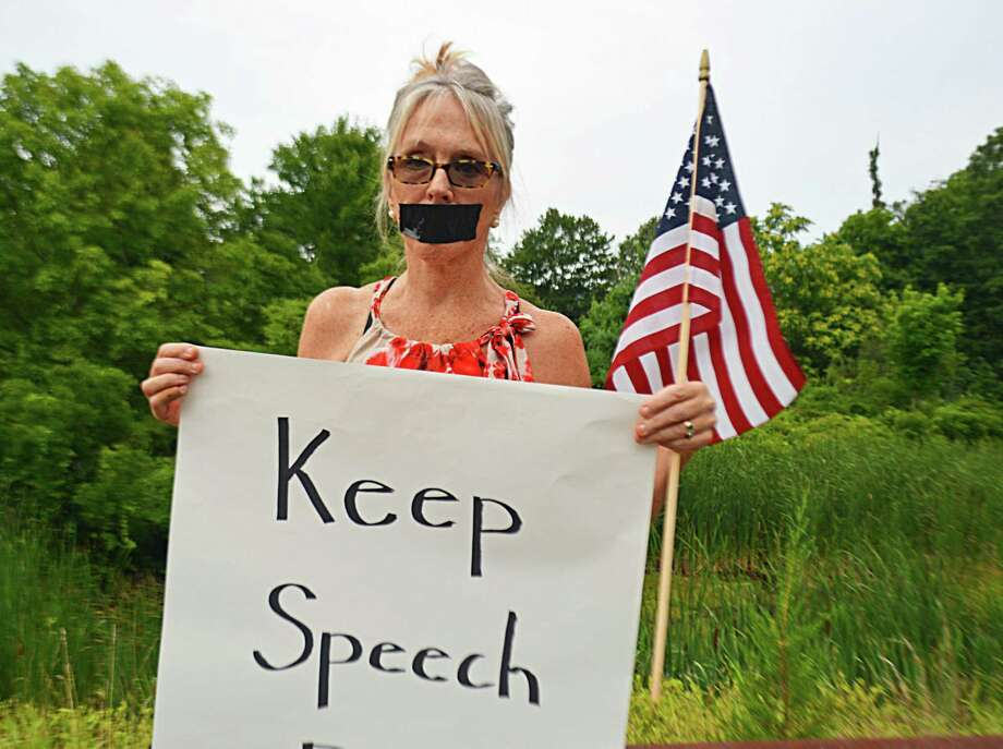 Haddam Selectwoman Melissa Schlag was condemned during the Board of Selectmen's meeting Monday night, as person after person spoke against her taking a knee during the Pledge of Allegiance. Her supporters formed a long line along the driveway leading to the Haddam firehouse, where the meeting was held, holding signs affirming their belief in the right of free speech. Photo: Cassandra Day / Hearst Connecticut Media