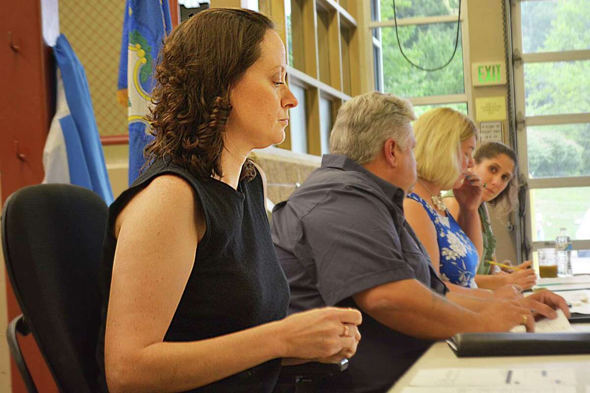 """Schlag is being vilified for calling Haddam """"fascist and racist"""" at the tail end of Monday night's selectmen meeting at the firehouse, where dozens protested her kneeling during the Pledge of Allegiance."""